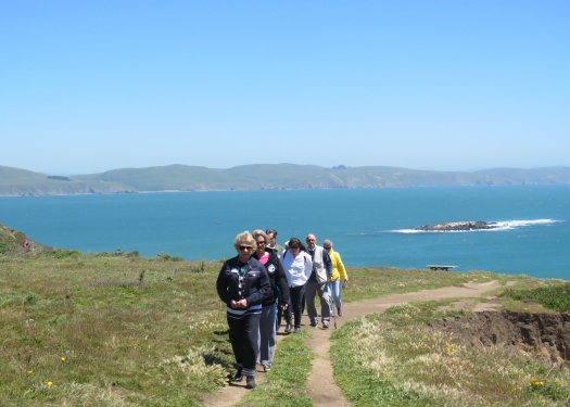 Sports Leisure travelers walk along a Bodega Bay bluff