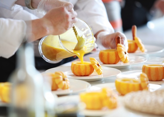 Close up of chefs working on food