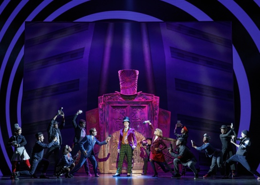 Noah Weisberg as Willy Wonka and company