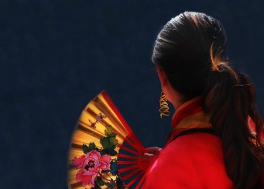 Woman with butterfly fan