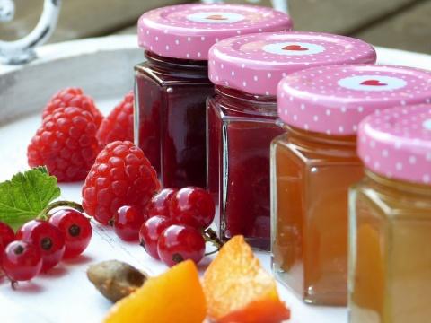Jars of jam and fresh fruit