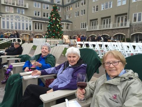 Sports Leisure travelers enjoying drinks outside at the Ritz Carlton