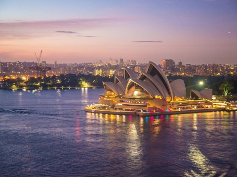 View of nightime Sydney skyline with Opera House